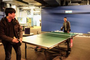 PowderMonkey team playing ping pong