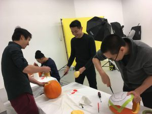PowderMonkey team carving pumpkins for Halloween